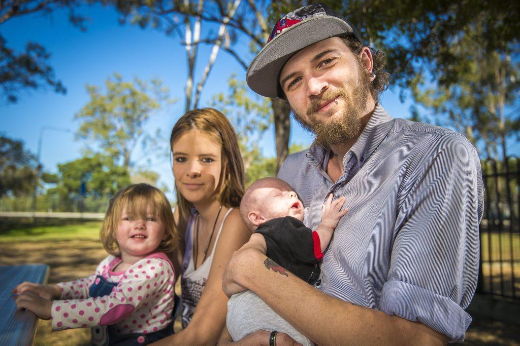 Laylah Gardiner, 19 months, Brittnee Gardiner, Mark Jarram and Hunter Gardnier-Jarram, 10 weeks at Lions Park, Gladstone. Photo Luka Kauzlaric / The Observer