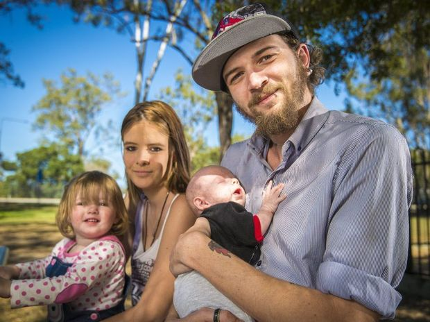 Laylah Gardiner, 19 months, Brittnee Gardiner, Mark Jarram and Hunter Gardnier-Jarram, 10 weeks at Lions Park, Gladstone. Photo Luka Kauzlaric / The Observer