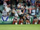 Johnathan Thurston dives for a no-try during the NRL semi-final between the Sydney Roosters and the North Queensland Cowboys at Allianz Stadium, in Sydney, Friday, Sept. 19, 2014.