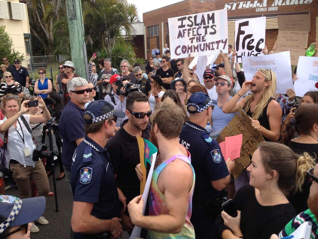 Anti-Islamic groups and those calling for tolerance clash at an anti-mosque rally on Queensland's Sunshine Coast.