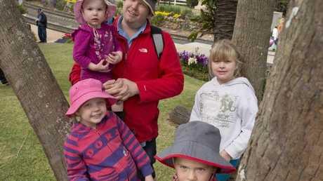 Adrian Dean with his children and their cousin (from left) Chloe Kearton, Ada Dean, Richard Dean and Aimee Dean at the Spring Bluff Railway Station