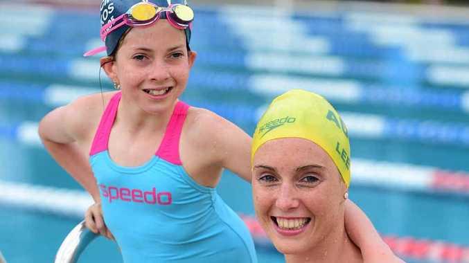 SWIMMING BUDDIES: Mountain Creek-Mooloolaba Swimming Club's Sarah Wallace, 12, and Kareena Lee who represented Australia at the Pan Pacifics in August.