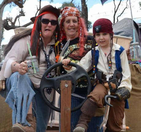 Diane Lense, Janette White and Noah Spencer get into the spirit of the Bony Mountain Country Music Festival, running the Pirate Cove for kids.