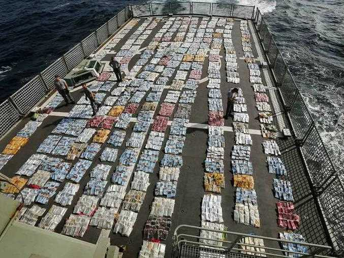 Members of HMAS Toowoomba account for and weigh 5.6 tonnes of cannabis resin on the flight deck of HMAS Toowoomba during Operation Manitou. A supplied image obtained Sunday, 21st Sept. 2014 shows HMAS Toowoomba during the operation to seize drugs.