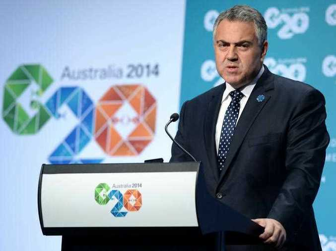 Australian Treasurer Joe Hockey looks on during a press conference at the G20 Finance Ministers and Central Bank Governors are meeting in Cairns, Sunday, Sept. 21, 2014.