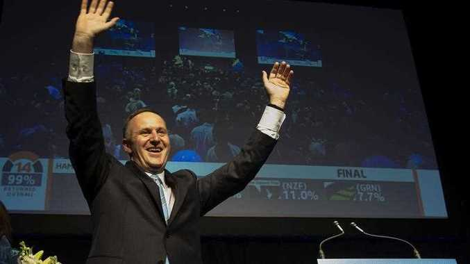 New Zealand Prime Minister John Key celebrates after winning the general election at the 2014 New Zealand National Party election event at Viaduct Event Center in Auckland on September 20, 2014. New Zealand's Prime Minister John Key said he was