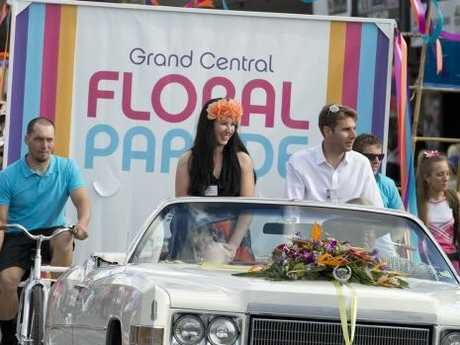 Carnival ambassador Libby Coghlan with IndyCar champ Will Power at the start of the Grand Central Floral Parade of Carnival of Flowers 2014.