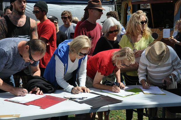 Protesters queued up to sign petitions against the west Byron development Photo Contributed