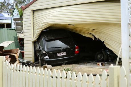 A car crashed into a garage at a property on Waterworks Road at North Ipswich. Photo: David Nielsen / The Queensland Times