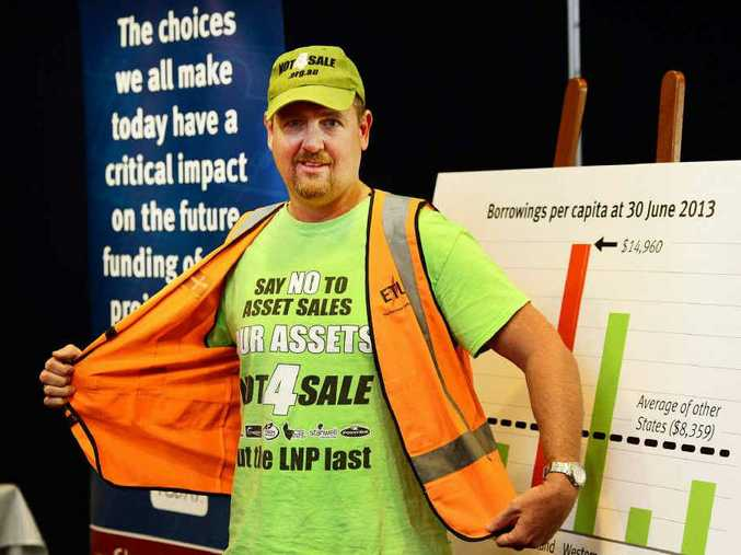 SAVE OUR ASSETS: Electrical Trades Union organiser Stuart Traill is unimpressed with Ipswich West MP Sean Choat's attitude to electricity assets.