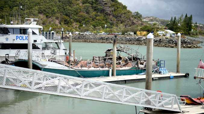 MILLIONS IN DAMAGE: A number of vessels, including the Freedom Flyer, were destroyed by fire at Rosslyn Bay Harbour (inset) at the weekend.