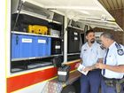 Rural Fire Service Queensland acting south-west regional manager Acting Superintendent Lawrence Laing and Darling Downs district officer Inspector Mike Curtin discuss a new communications trailer.