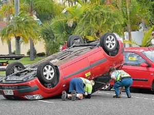 Driver distraction blamed for car flip at Mooloolaba