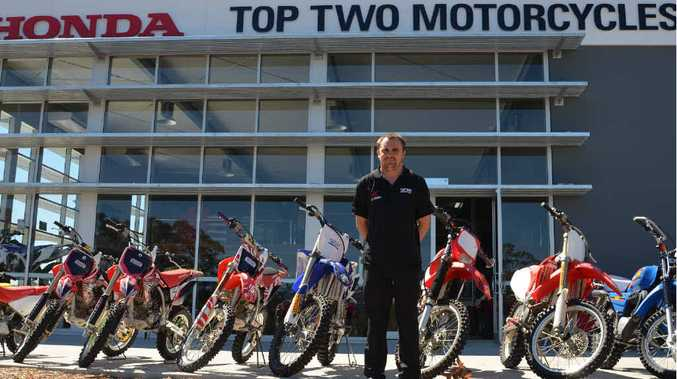 NEW DIGS: Top Two Motorcycles owner Peter Lippi out the front of his new store.