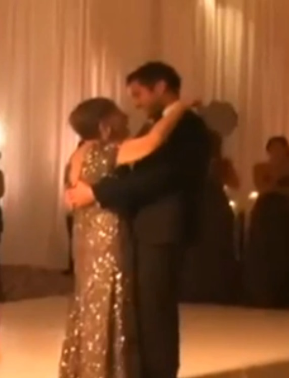 Ryan Manning dances with his terminally ill mother Mary Ann at his wedding. His mother would lose her battle with breast cancer just days later.