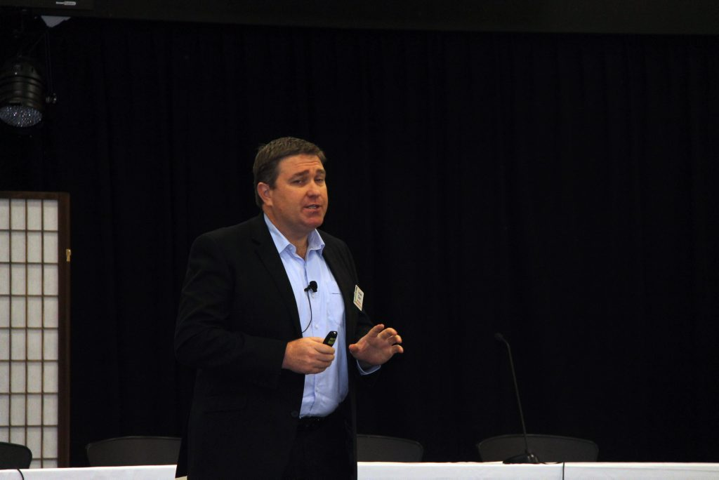 Lucas Dow speaking at the conference. Photo Kelly Butterworth / CQ News
