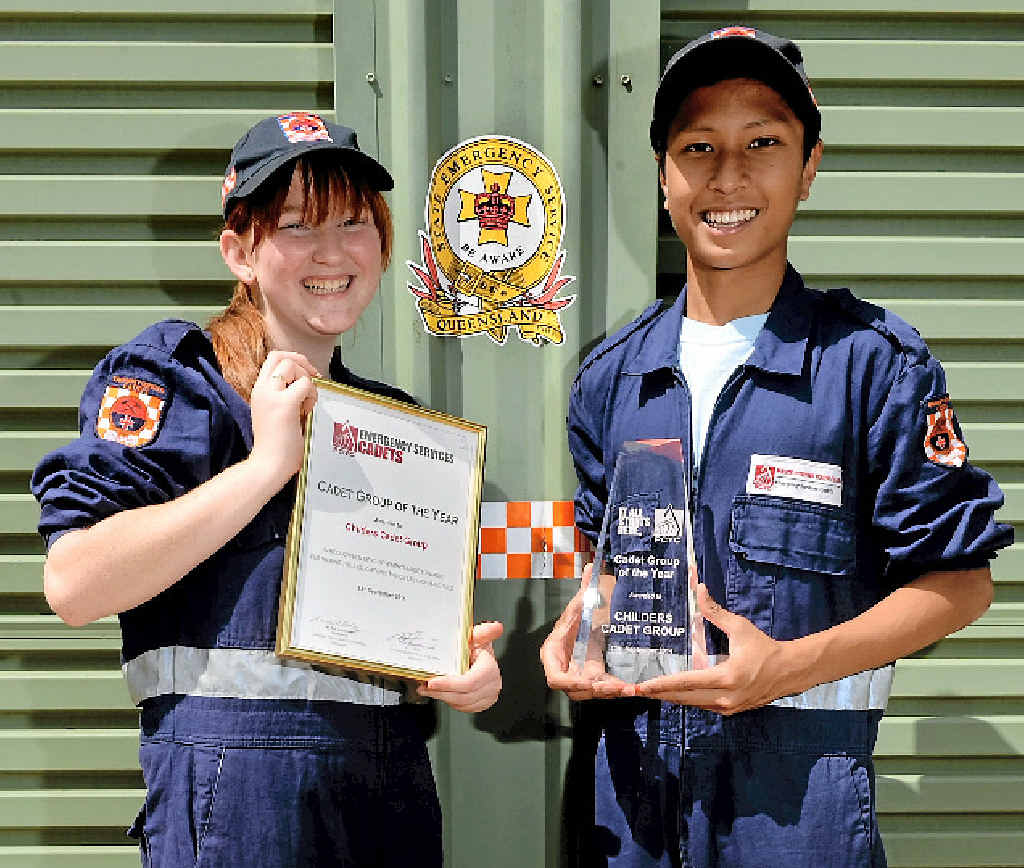 SERVING WITH A SMILE: Brienna Cottam and Thakdanai Dinmaung with the trophies awarded to the Childers Cadet Group.
