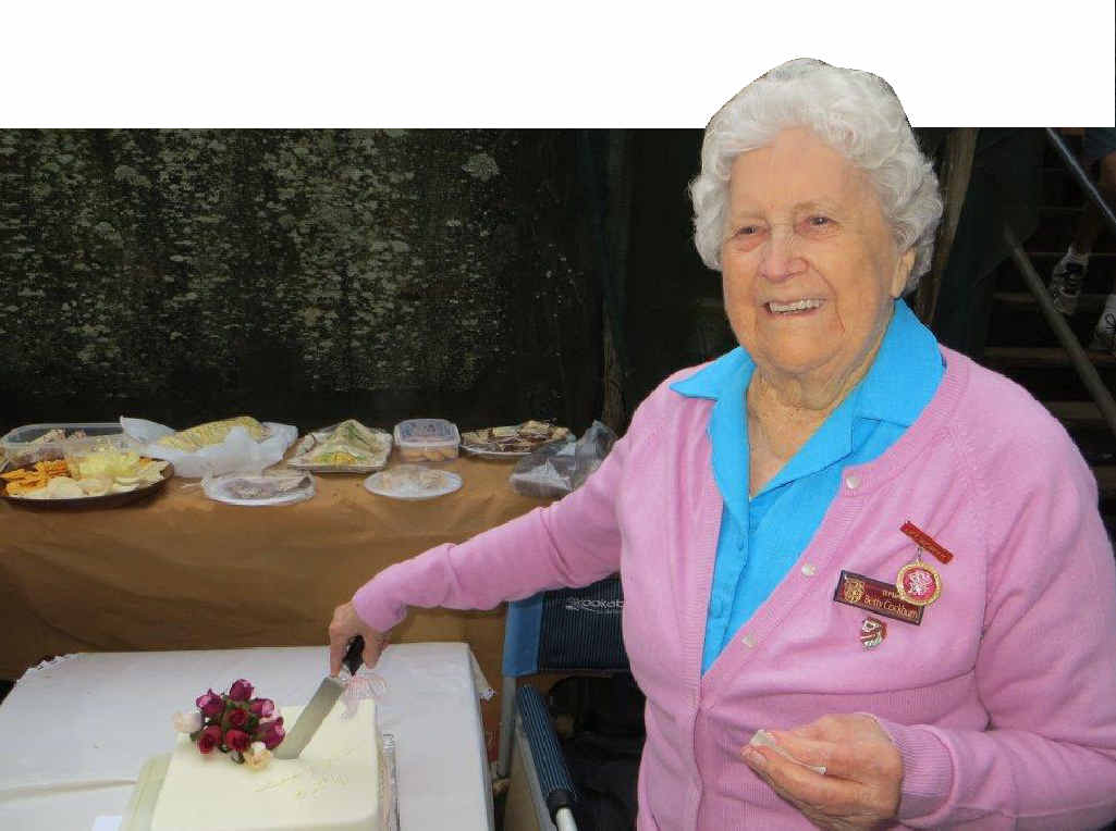 LEFT: Betty Cockburn cuts her special 90th birthday cake.