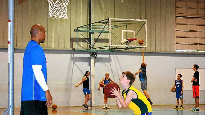 ROLE MODELS: CJ Bruton and his brother Austin held a training workshop for young basketballers at Southern Cross School's gym at Ballina on Tuesday.