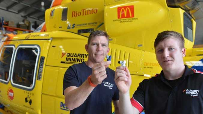 RACQ-CQ Rescue Air Crewman Damien Kross and Quarry Mining stores co-ordinator Phil Warren with the drill bits will help fundraiser for the rescue helicopter service.