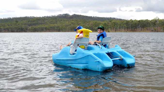 COOL WATERS: Alexander Connolly and Nicholas Briggs take to the water during Silver Wattle Day at the Mount Morgan Dam.