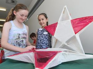 Lantern-making youngsters prepare to light the night