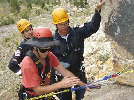 Climbing instructor Phil Box (front) shows Queensland Government rescue crew officers Brendan Collins (left) and Rod Edwards how to use a personal adjustable lanyard during training at Murphys Ck.
