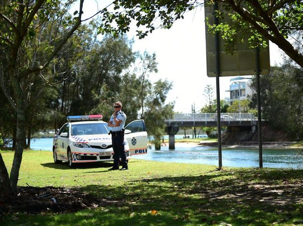 Police watch over the scene where a woman's body was found in the Maroochy River this morning. Photo: Iain Curry/Sunshine Coast Daily.