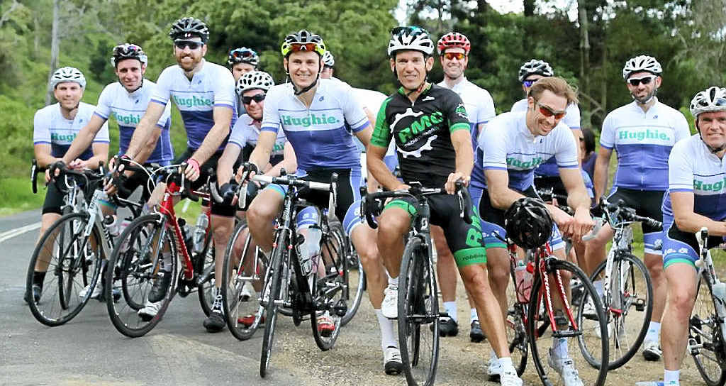 PEDAL POWER: Olympian Robbie McEwen (centre) joins organiser Paul Mellers and other cyclists on the Tour for Alpers bike ride from Brisbane to Byron Bay and back again to raise money for medical research.