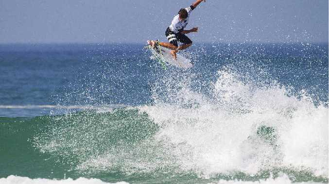BACK IN BUSINESS: Coolum Beach's Julian Wilson gets some air in his round one heat at the Quiksilver Pro France, advancing in first place after scoring 8.50 and 8.27, out of 10, on his two scored rides.