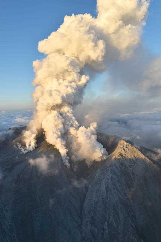 An aerial photo taken from Yomiuri Shimbun's helicopter shows the volcano of Mt. Ontake, a volcano spewing gray smoke up into the sky in between Gifu and Nagano Prefecture, central Japan on Sept. 27, 2014. The voclcano, straddling the two prefectures, erupted for the first time in 7 years. Japan's Meteorological Agency issued a warning for residents and climbers to stay away from Mount Ontake.