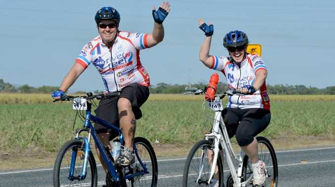 Shane Kruger and Fiona Kruger are all smiles as they take part in the River2Reef Charity Road along Sugarshed Road.