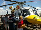 Crowds gather around the Toowoomba RACQ CareFlight helicopter at the Brisbane West Wellcamp open day. :Photo Contributed