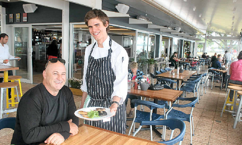 WE'RE OPEN: Owner of Ballina's Wharf Bar and Restaurant, Ralph Mamone, with first-year apprentice chef Matthew Payne who is on staff.