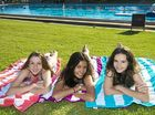 Pamela Redshaw, Lucy-Grace Cullen and Hayley Baldwin enjoy the new grassy space at Gladstone Aquatic Centre.