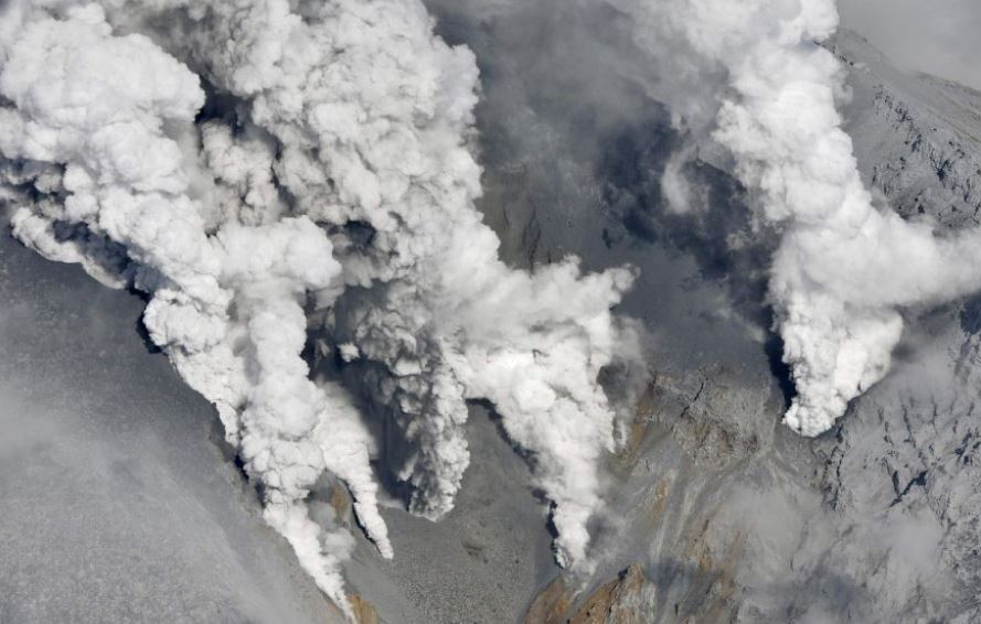 Smoke rises from Mount Ontake, which straddles Nagano and Gifu prefectures in Japan. Authorities have found the remains of 31 following the eruption