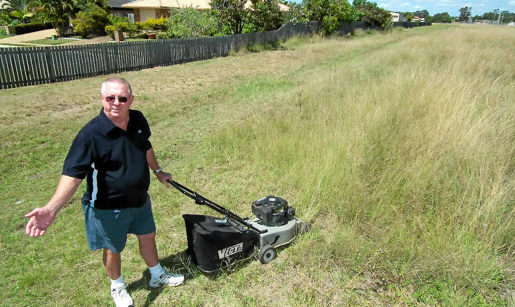 Kawungan resident Merv Dempsey is worried an overgrown allotment next to his home is going to be a fire hazard heading into summer and says council needs to do more to control it.