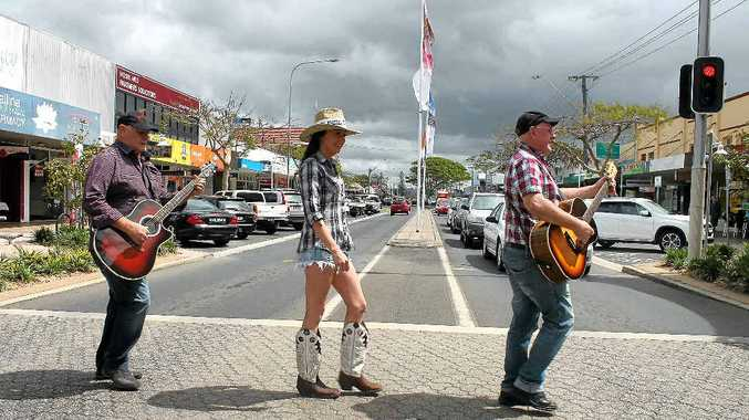 IT'S NOT ABBEY ROAD: But it's River St, Ballina, and John (left) and Al Alderman – known together as the Alderman Brothers – help promote the Ballina Coastal Country Music Festival with Lorraine Daniells, along with a ute driving around the CBD with country music being played over a PA.