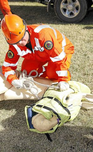 An SES volunteer learns how to rescue an animal.