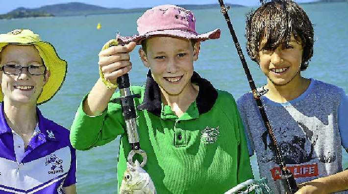Declan Scriffignano, 11, Declan King, 9, and Caelan, 9, spent their Monday fishing at Gladstone marina.