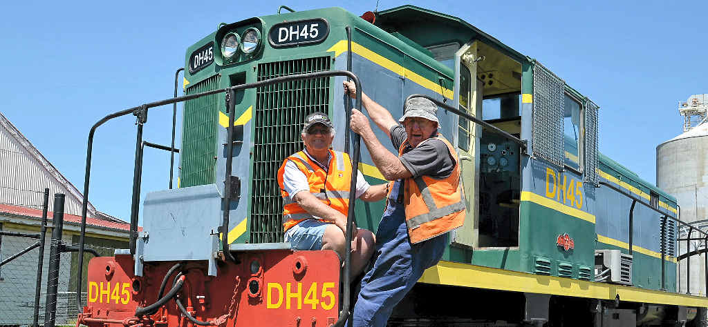 TRACKED DOWN: Southern Downs Steam Railway president Peter Gregory and fitter John Brady with the new 40-tonne diesel locomotive from Gympie.