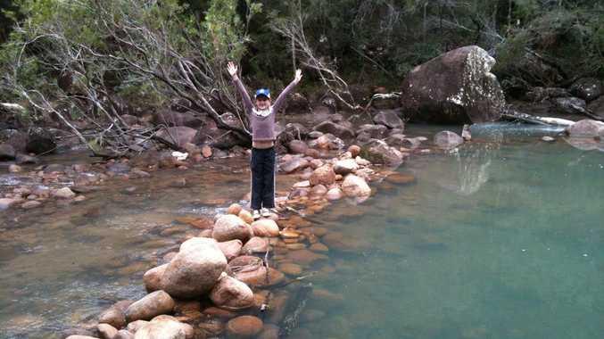 Chelsea standing on a rock bridge at Stony Creek, Byfield