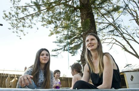 TREE RESCUE: Newtown family (from left) Sommer Cooney, Freya Hakanson, Belle Cooney and their mother Megan Hakanson are fighting to protect a 100-year-old Norfolk pine in their backyard.