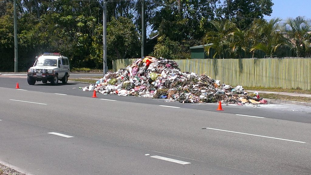 A large pile of garbage on Benabrow Ave, Bellara, following a garbage truck fire. Photo Contributed.