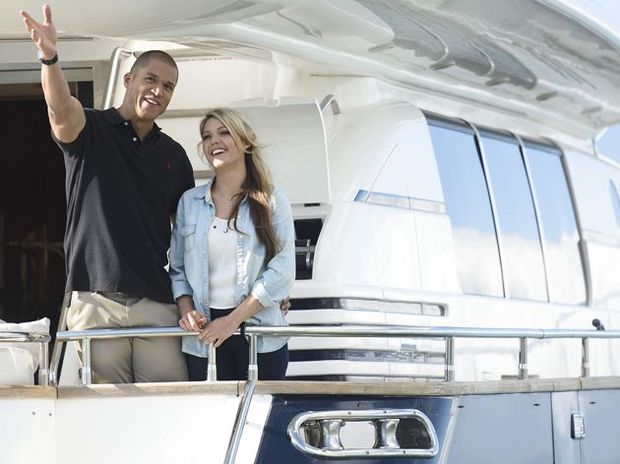 Blake Garvey and Sam Frost enjoy the view of Cape Town from the water.