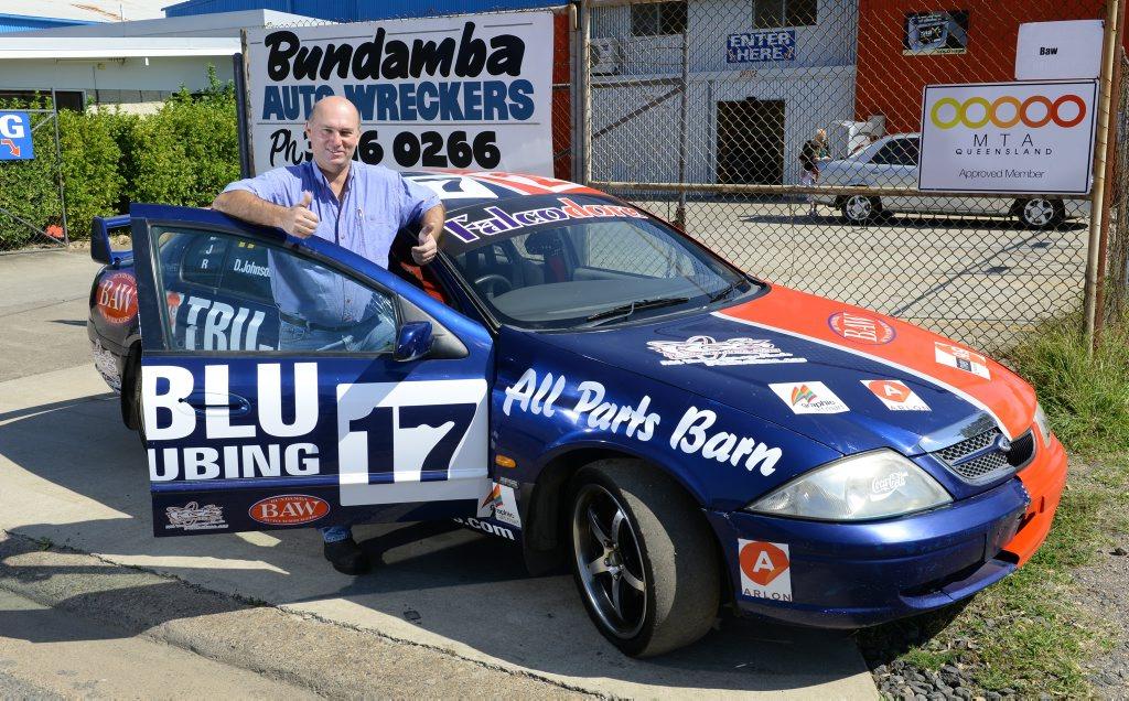Dean Hawkins from Bundamba Auto Wreckers with the Falcodore; Half Ford Falcon (left), half Holden Commodore (right). Photo: Rob Williams / The Queensland Times