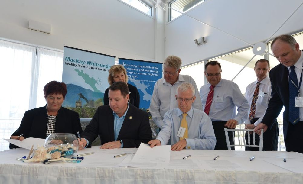 Mayor Deirdre Comerford, Qld Minister for Environment and Heritage Andrew Powell, Queensland Resources Council CEO Michael Roche are the first to sign the partnership deal as Resource Industry Network CEO Julie Boyd, Chair of GBRMPA Russell Reichelt, CEO of NQ Bulk Ports Steven Lewis, CSIRO's David Brewer and Mackay Regional Council's director of Community and Client Services Gerard Carlyon.