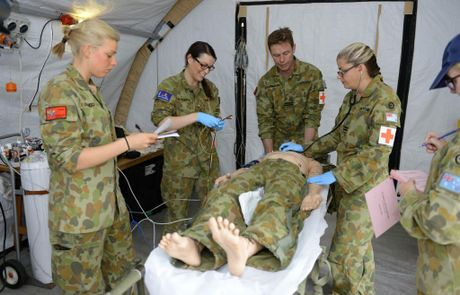 RAAF personnel treat a mock patient inside the emergency field resuscitation tent.