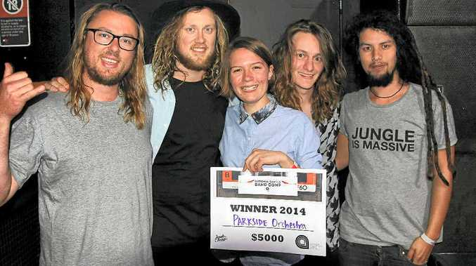 SOUNDS OF SUCCESS: Stephen Sewell (Jungle Studios director), Torsten Gustavsson (guitar/vocals), Freyja Hooper (drums), Scott Finch (bass) and Phan Sjarif (Jungle Studios studio manager) following Parkside Orchestra's win in the final of the National Campus Band Competition in Sydney on Wednesday night.