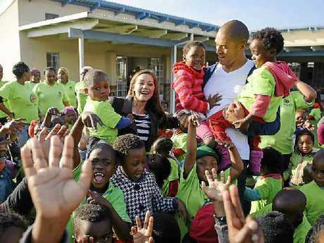 YAY! The Bachelor, Blake Garvey, and Lisa Hyde meet schoolchildren in Cape Town, South Africa, during the show's filming.
